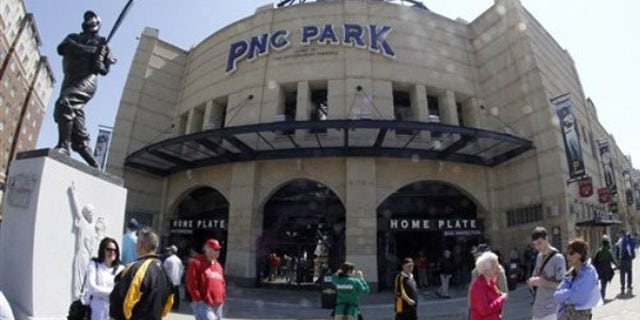 April 7, 2011: Fans mingle near the home plate entrance and the statue of former Pirates great Honus Wagner before the Pirates home opener baseball game against the Colorado Rockies in Pittsburgh.