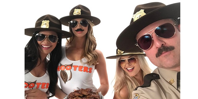 "Hannah Williams (left) spending time with other Hooters girls and the cast of ""Super Troopers 2."""