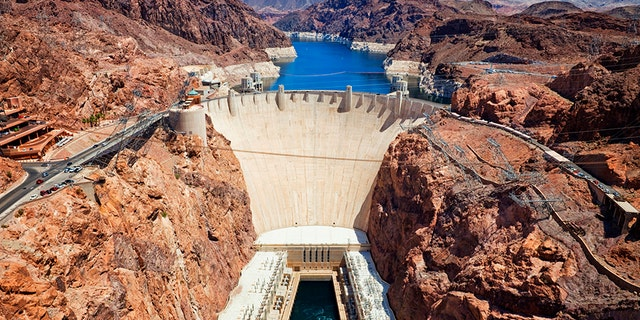 A man, possibly armed, barricaded himself inside an armored vehicle somewhere near the Hoover Dam and U.S. Highway 93 southbound, reports say.
