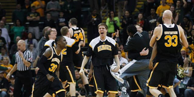 Milwaukee players celebrate after defeating Wright State 69-63 in an NCAA college basketball game for the Horizon League men's tournament championship, Tuesday, March 11, 2014, in Dayton, Ohio. (AP Photo/Dayton Daily News, Ty Grenlees) LOCAL PRINT OUT AND LOCAL TV OUT (WKEF, WRGT, WDTN)