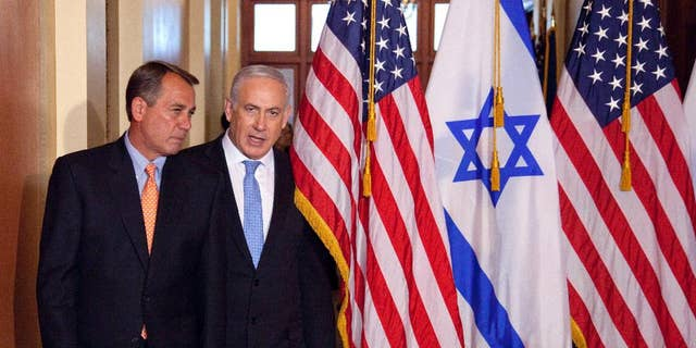 FILE - In this May 24, 2011 file photo, Israeli Prime Minister Benjamin Netanyahu walks with House Speaker John Boehner of Ohio on Capitol Hill in Washington. Israel's ambassador to the US has gotten an earful from a half-dozen House Democrats angered by Prime Minister Benjamin Netanyahu's acceptance of a Republican invitation to address Congress next month. Boehner's invitation came with the Obama administration in negotiations with Iran over its nuclear program. Boehner's move has angered the White House and Democrats.  (AP Photo/Evan Vucci, File)