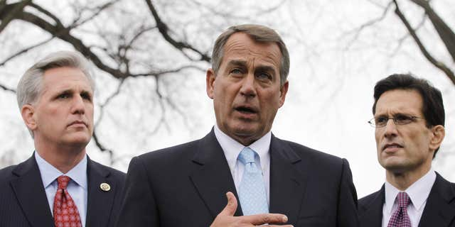 In this Feb. 9, 2011, file photo House Speaker John Boehner of Ohio, center, with House Majority Leader Eric Cantor of Va., right, and House Majority Whip Kevin McCarthy of Calif., speaks to reporters outside the White House in Washington. (AP)