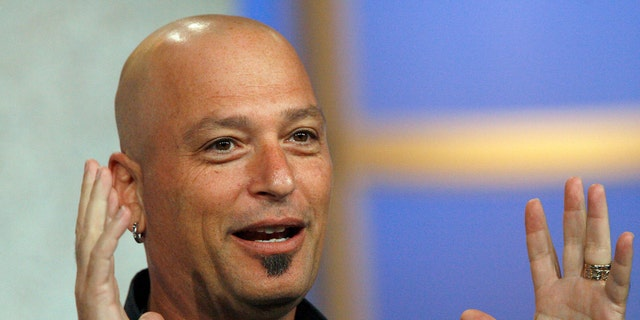 """Host Howie Mandel gestures at the panel for the NBC television show  """"Deal Or No Deal"""" at the Television Critics Association summer 2006 media tour. (REUTERS/Mario Anzuoni)"""
