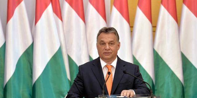Hungarian Prime Minister Viktor Orban addresses a conference held on the occasion of the 5th anniversary of the formation of his government in 2010 in the atrium of the Budapest History Museum in Budapest, Hungary, Friday, May 29, 2015.
