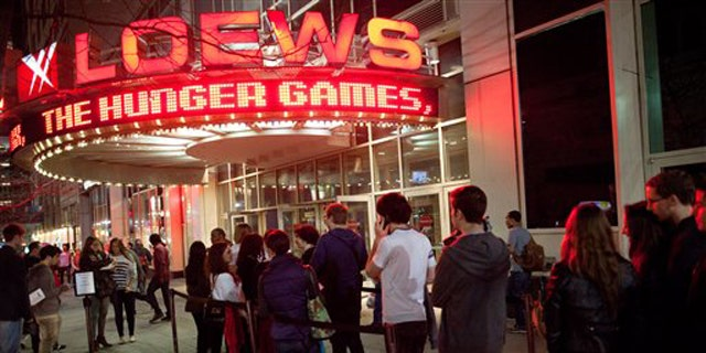 """March 22, 2012: Fans line up to see the midnight shows of """"The Hunger Games,"""" at the 34th Street Loews AMC Theatre in New York."""
