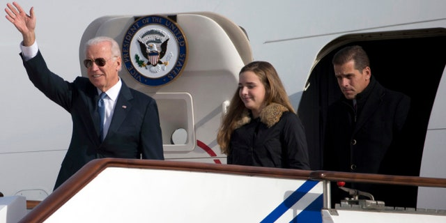 FILE: Dec. 4, 2013: from left, Vice President Joe Biden, granddaughter Finnegan Biden, son Hunter Biden, arriving in Beijing, China.