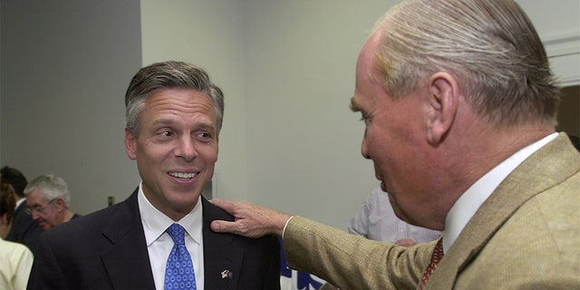 Jon Huntsman, Jr., learns from his father, Jon Huntsman, Sr. that his son was declared the winner by The Associated Press during the Republican primary election Tuesday, June 22, 2004, in Salt Lake City. Huntsman opposed Nolan Karras to be the GOP's gubernatorial candidate. (AP Photo/Douglas C. Pizac)