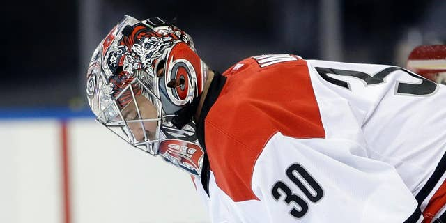 Carolina Hurricanes goalie Cam Ward looks down after New York Rangers' Benoit Pouliot scored during the second period of an NHL hockey game Tuesday, April 8, 2014, in New York. (AP Photo/Frank Franklin II)