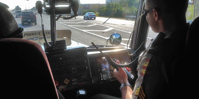 State troopers hide in plain sight to recapture the attention of distracted drivers.