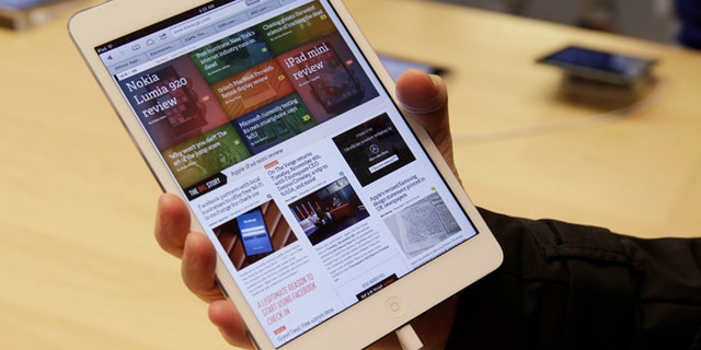 FILE 2012: A shopper checks out the new Apple iPad mini at the Apple store on Michigan Ave. in Chicago.