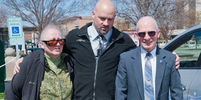 April 25: Alan Beaman center, walks with his parents, Carol and Barry Beaman after formally being declared innocent at a hearing at the Champaign County Courthouse in Urbana, Ill.