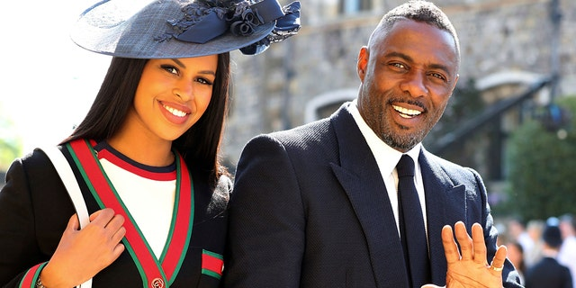 Idris Elba and Sabrina Dhowre arrive for the wedding ceremony of Prince Harry and Meghan Markle at St. George's Chapel in Windsor Castle in Windsor, near London, England, Saturday, May 19, 2018. (Gareth Fuller/pool photo via AP)