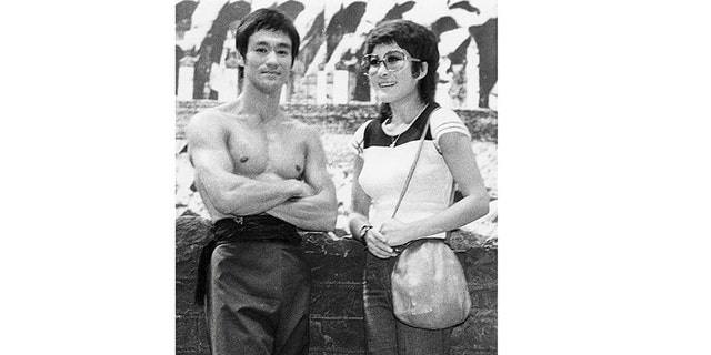 """Bruce and Betty Ting Pei on the Hong Kong Coliseum studio set for """"Way of the Dragon,"""" June 1972."""