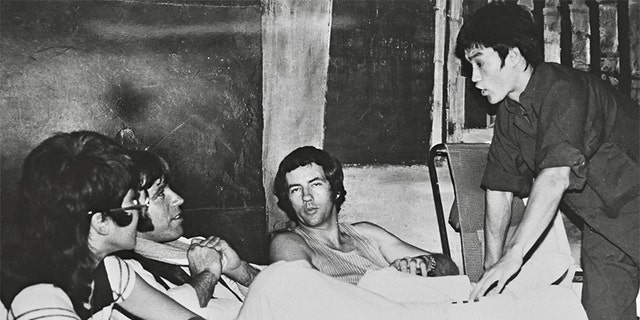 """Left to right: Betty Ting Pei, Chuck Norris, Bob Wall and Bruce Lee at Golden Harvest studios during filming of """"Way of the Dragon,"""" June 1972."""