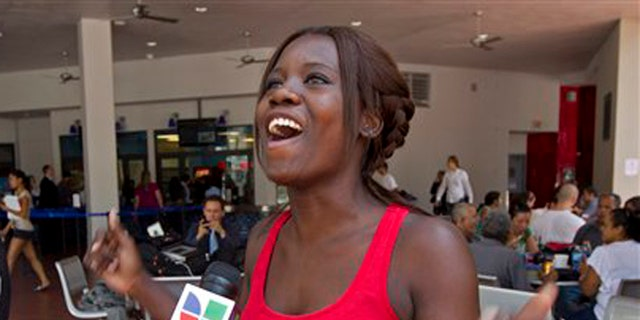 FILE: June 15, 2012: Niouseline St. Jean, from Turks and Caicos Islands who lives in the U.S. illegally reacts to a new immigration ruling for students.