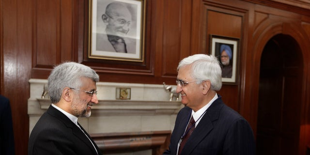 Jan. 4, 2013 - Indian Foreign Minister Salman Khurshid, right, shakes hands with Iran's Supreme National Security Council Secretary and chief Nuclear negotiator Saeed Jalili, in New Delhi, India.