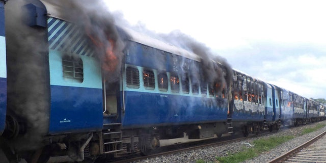 Aug.19, 2013 - Coaches of the Rajya Rani Express train burn after a mob set it on fire as it ran over a group of Hindu pilgrims at a crowded station in Dhamara Ghat, Bihar state, India. At least 37 people were killed.