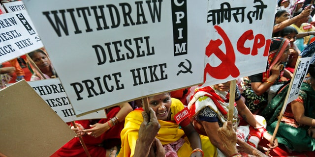 Sept. 20, 2012: Supporters of Communist Party of India (Marxist) participate in a protest with placards in New Delhi, India.