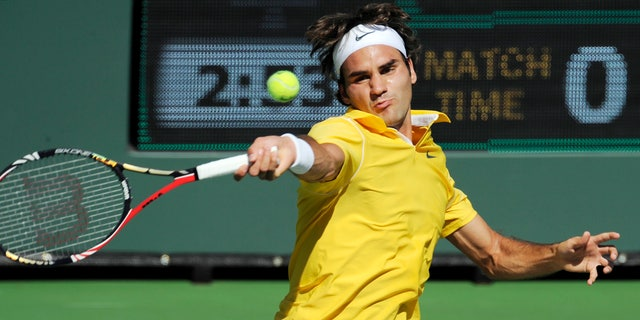 March 15: Roger Federer, of Switzerland, returns a shot to Juan Ignacio Chela, of Argentina, during their match at the BNP Paribas Open tennis tournament in Indian Wells, Calif.