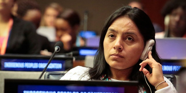 Ati Quigua, an indigenous leader from Colombia, listens during the 15th session of the U.N. Permanent Forum on Indigenous Issues, Tuesday May 17, 2016 at U.N. headquarters. (AP Photo/Bebeto Matthews)