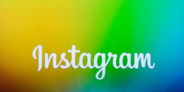 A screen displays the Instagram logo during a presentation by co-founder Kevin Systrom Dec. 12, 2013.