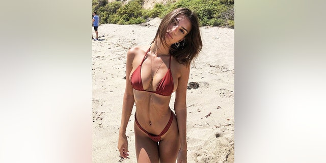 Emily Ratajkowski advocates for women to embrace their bodies and wear bikinis on the beach, and even to a protest if they want to.
