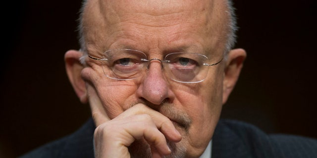 In this Jan. 29, 2014 file photo, Dir. of National Intelligence James Clapper, testifies before the Senate Intelligence Committee hearing on Capitol Hill in Washington.