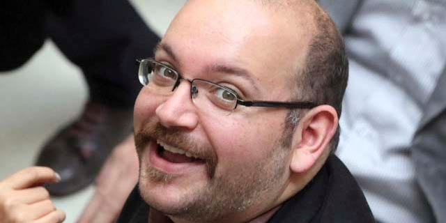 FILE - In this April 11, 2013 file photo, Jason Rezaian, an Iranian-American correspondent for the Washington Post smiles as he attends a presidential campaign of President Hassan Rouhani in Tehran. (AP Photo/Vahid Salemi, File)