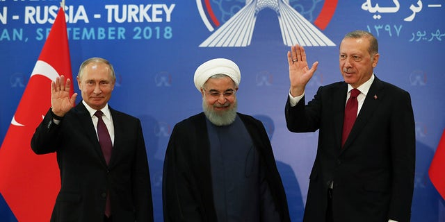 Russia's Vladimir Putin, Iran's Hassan Rouhani and Turkish President Recep Tayyip Erdogan