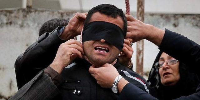 The victim's parents remove the noose.
