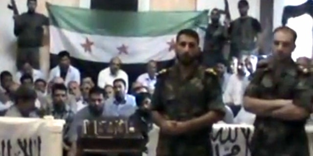 This image from a video released by the Baraa Brigades purports to show Free Syrian Army soldiers guarding a group of Iranians captured a day earlier.