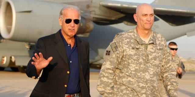 August 30: Vice President Joe Biden, walks with Gen. Ray Odierno, as he arrived in Baghdad, Iraq. (AP)