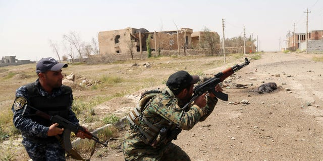 March 30, 2015 - Iraqi security forces attack Islamic State extremists in the streets of Tikrit, 80 miles north of Baghdad, Iraq.