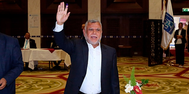 Hadi al-Amiri, commander of the Popular Mobilization Forces, gestures after casting his ballot in the country's parliamentary elections in the heavily fortified Green Zone in Baghdad, Iraq.