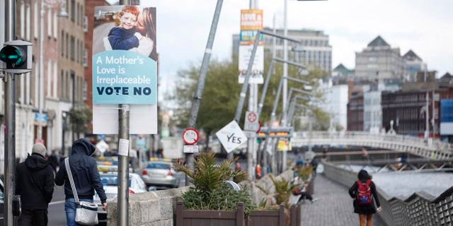 May 18, 2015: No and Yes campaign posters are seen in Dublin, Ireland. (AP Photo/Peter Morrison)