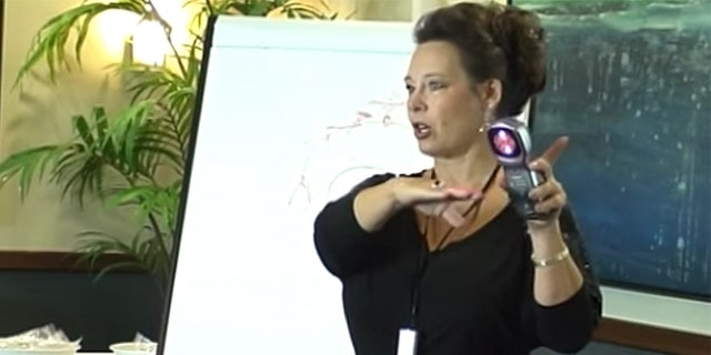 Kossovskaia, pictured in a still taken from a video in which she demonstrates how to use the QLaser, was sentenced to 15 months in prison.