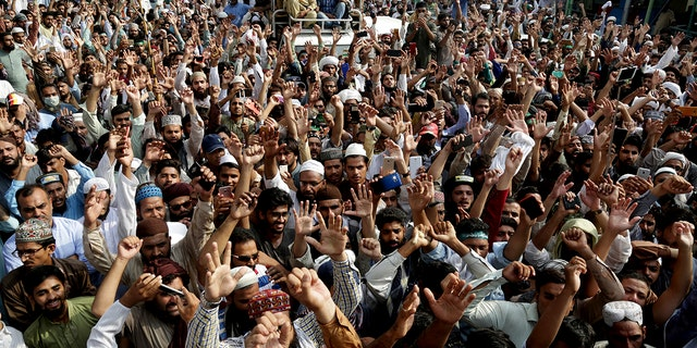 Supporters of Pakistani religious group shout slogans during a march towards Islamabad Wednesday in Lahore, Pakistan. Thousands of Islamists in Pakistan launched a march toward the capital to protest a far-right Dutch lawmaker's plans to hold a Prophet Muhammad cartoon contest later this year. Physical depictions of the prophet are forbidden in Islam, and deeply offensive to Muslims.