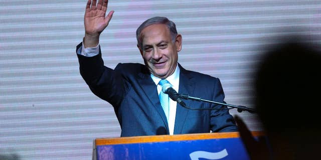 FILE - In this Wednesday, March 18, 2015 file photo, Israeli Prime Minister Benjamin Netanyahu greets supporters at the party's election headquarters In Tel Aviv. Before the elections, Israel had already become a source of division, rather than unity, for American Jews, who bitterly debated the ever-expanding Jewish settlements in Palestinian territories and the acceptable boundaries of dissent from Israeli policies. The outcome of the Israeli election will only deepen that polarization, experts say. Netanyahu's anti-Arab campaign rhetoric and his rejection of a Palestinian state, they say, will further splinter American Jews into hard left and right camps, and intensify conflicts over what it means to be loyal to the Jewish state. (AP Photo/Oded Balilty)