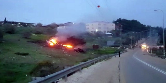 The wreckage of the jet is seen on fire near Harduf, northern Israel, on Saturday, Feb. 10, 2018.