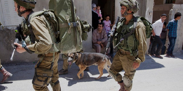 June 15, 2014. Israeli soldiers patrol during a military operation to search for three missing teenagers outside the West Bank city of Hebron.