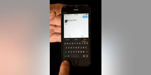 A reporter demonstrates the SwiftKey keyboard on an iPhone.