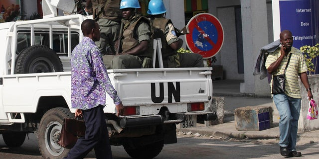 """UN forces patrol on a street of, Ivory Coast, Abidjan, Wednesday, Dec. 22, 2010. The U.N. chief has warned that Ivory Coast faces """"a real risk"""" of return to civil war, and that U.N. peacekeepers will face a critical situation in the coming days unless Laurent Gbagbo removes a blockade around his opponent's headquarters."""