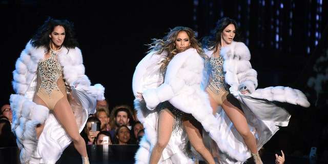 """Jennifer Lopez performs with dancers during the launch of her residency """"JENNIFER LOPEZ: ALL I HAVE"""" at The Axis at Planet Hollywood Resort & Casino on January 20, 2016 in Las Vegas, Nevada."""