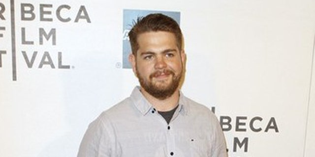 "FILE: Jack Osbourne poses as he arrives for a screening of ""The Bang Bang Club"" during the Tribeca Film Festival in New York."