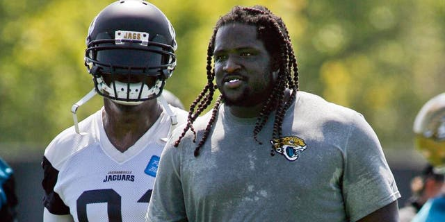 Jun 16, 2015; Jacksonville, FL, USA; Jacksonville Jaguars defensive end Chris Clemons (91) and defensive tackle Sen'Derrick Marks (99) during minicamp at the Florida Blue Health and Wellness Practice Fields. Mandatory Credit: Phil Sears-USA TODAY Sports