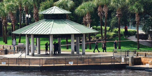 Police investigate the scene at Jacksonville Landing on Sunday, Aug, 26, after a mass shooting during a Madden Championship Series competition