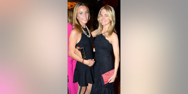 Jacqueline Kent Cooke, here with fellow socialite Amanda Hearst is seen clutching the purse believed to be used in the alleged assault during an event in April.
