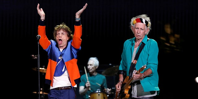 Mick Jagger (left) and Keith Richards (right) of The Rolling Stones are seen in this file 2016 photo performing during Desert Trip music festival at Empire Polo Club in Indio, California.