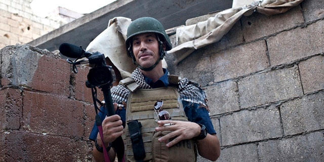 This November 2012 photo, posted on the website freejamesfoley.org, shows American journalist James Foley while covering the civil war in Aleppo, Syria.