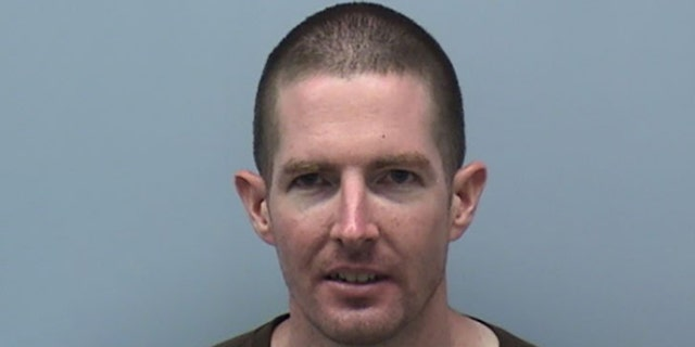 James Trainor was arrested Monday after allegedly throwing a brick at the glass door of Sen. Mark Warner's Virginia office. Police said they do not believe the vandalism was random.